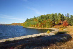 Colorful shoreline of Barkhamsted Reservoir in October. Royalty Free Stock Images