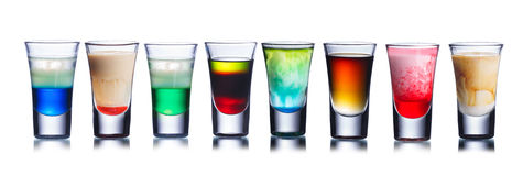 Colorful shot drinks isolated on white Royalty Free Stock Images
