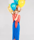 Colorful shot of teen girl with balloons Royalty Free Stock Images