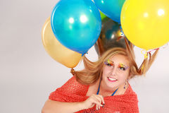 Colorful shot of teen girl with balloons Royalty Free Stock Image