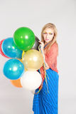 Colorful shot of teen girl with balloons Royalty Free Stock Photos