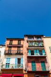 Colorful Shutters Awnings and Plaster. Colorful buildings in the coastal town of Villefranche, France Royalty Free Stock Photography