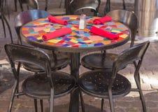 Colorful Sidewalk Cafe Table Setting Stock Image