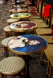 Colorful sidewalk cafe tables Royalty Free Stock Images