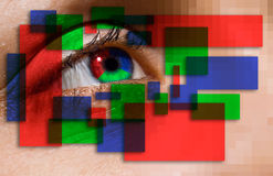 Colorful Sight. A metaphorical image of an eye with colorful blocks in red, green and blue colors around it, depicting colorful vision Stock Photography