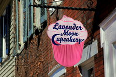 Colorful sign advertising business, Lavender Moon Cupcake, Old Town Alexandria,Virginia,April,2015 Royalty Free Stock Photography