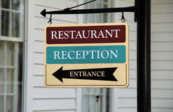 Colorful sign giving direction to visitors Stock Photos