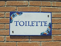 Colorful sign with the indication of the toilet. Ceramic colorful sign with the indication of the toilet Royalty Free Stock Image
