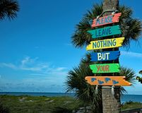 A colorful sign reads `please leave nothing behind but your footprints` stock images