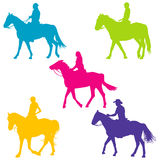 Colorful silhouettes of horse riders Stock Photo