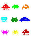 Colorful silhouettes of space invaders. On a white background Royalty Free Stock Images