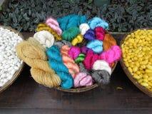 Colorful Silk examples - Jim Thompson House. Colorful examples of silk in bowl  at Jim Thompson House Bangkok Stock Photo