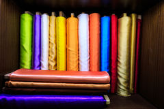 Colorful silk fabrics on roll Stock Photos