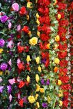 Colorful silk flower garlands for sale in Hanoi, Vietnam market. They look like the real thing, even close-up Stock Images