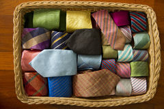 Colorful silk neck ties collection in wood  basket. Colorful silk neck ties collection in wood  basket Stock Images