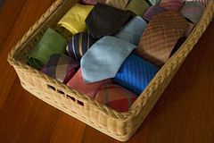 Colorful silk neck ties collection in wood  basket. Colorful silk neck ties collection in wood  basket Royalty Free Stock Image