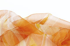 Colorful silk orange scarfs background Royalty Free Stock Photo