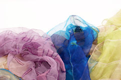 Colorful silk scarves on white background Stock Image