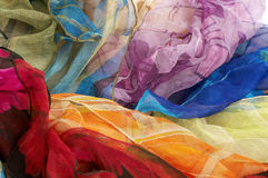 Colorful silk scarves on white background Stock Images