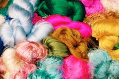 Colorful silk wigs. Bright colored wig Stock Images