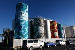 Popular tourist sightseeing attraction of colorful painted silos in sunny blue sky in Wynyard Quarters, Auckland, New Zealand royalty free stock images