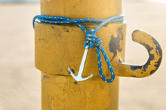 Colorful silver anchor wristband with blue rope Stock Photo