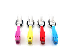 Colorful silverware. Colorful forks knifes and spoons with white background Royalty Free Stock Image