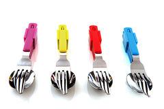 Colorful silverware. Colorful forks knifes and spoons with white background Stock Photography