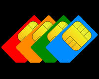 Colorful sim card. On a black background Stock Photos