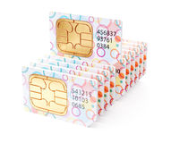 Colorful SIM cards row stack. Mobile technology wireless telecommunication internet dial concept . Colorful SIM cards row stack for smartphones and mobile phones Royalty Free Stock Images
