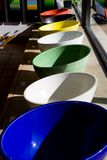 Colorful sinks. A lineup of colorful sinks taken at a ceramics store stock photos