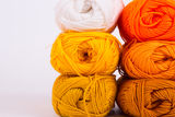 Colorful skeins of Yarn. In block with white background Stock Photography