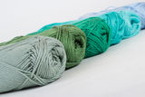 Colorful skeins of Yarn. In row Stock Photos