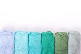 Colorful skeins of Yarn. In row Royalty Free Stock Photo
