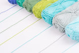 Colorful skeins of Yarn. In row with white background Royalty Free Stock Image