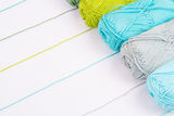 Colorful skeins of Yarn. In row with white background Royalty Free Stock Photo