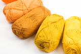 Colorful skeins of Yarn. Warm Royalty Free Stock Photos