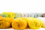 Colorful skeins of Yarn. Warm color round Royalty Free Stock Photos