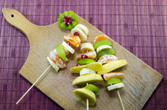 Colorful Skewered Fruit On A Cutting Board