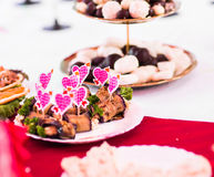 Colorful skewers with hearts for snacks royalty free stock photos