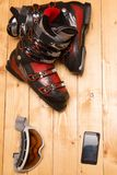 Colorful ski glasses, gloves and helmet. On wooden table. Winter ski theme stock photo