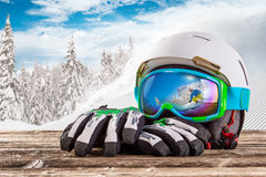 Colorful ski glasses, gloves and helmet Stock Photos