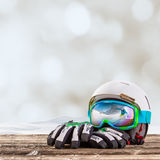 Colorful ski glasses, gloves and helmet Royalty Free Stock Photos