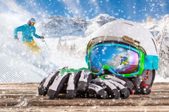 Colorful ski glasses, gloves and helmet Royalty Free Stock Image