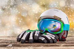 Colorful ski glasses, gloves and helmet Royalty Free Stock Photography