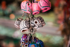 Colorful skulls mexican souvenirs. Traditional Mexican souvenir skulls on the market. Travel background for Mexico, Latin America Stock Photography