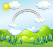 A colorful sky above the green hills Royalty Free Stock Images