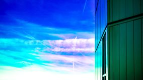 Colorful Sky And Building. This image is of the side of a building with a colorful sky as a backdrop stock photo
