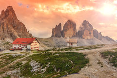 Colorful sky,chapel and shelter in high mountains,Dolomites,Italy Royalty Free Stock Photography