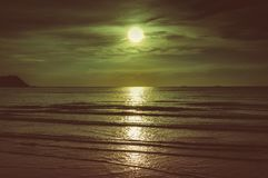 Colorful sky with cloud and bright full moon over seascape. Colorful sky with cloud and bright full moon over seascape in the evening. Serenity nature Stock Photos